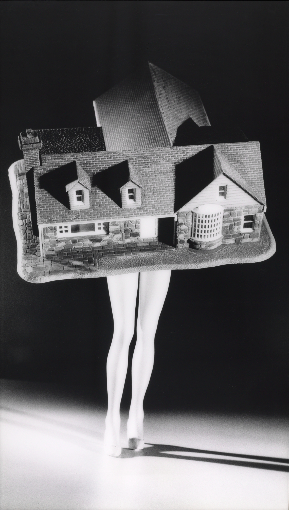 """Laurie Simmons. Walking House. 1989, printed 1997. From the series """"Walking Objects"""". The Baltimore Museum of Art:  Given by the Board of Trustees and Staff in Honor of Arnold L. Lehman, Director, 1979-1997. BMA 1997.130. © Laurie Simmons, Courtesy of the artist and Salon 94, New York"""