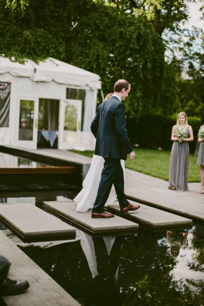 couple walking across pond